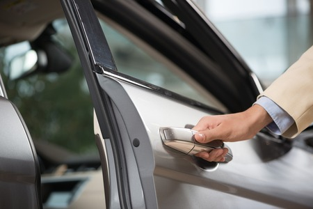 opening up: Close up of human male hand opening car door