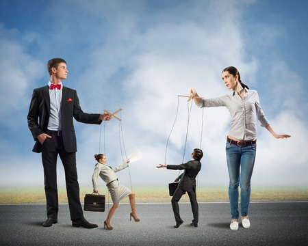 puppeteers holding the strings of puppets business, business concept control