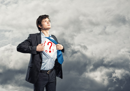 superman: businessman breaks the shirt, under which the question marks, on a background of clouds