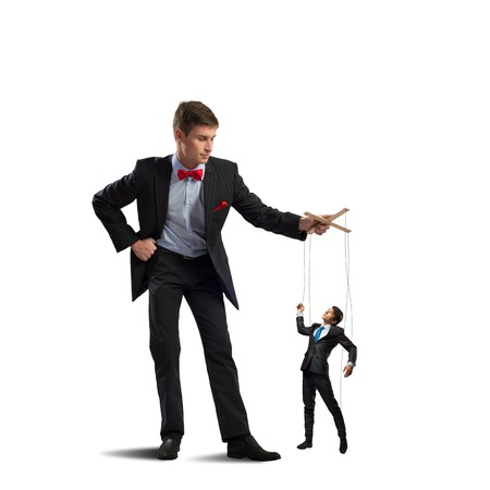 puppeteer: puppeteer holds the puppet business man on the ropes