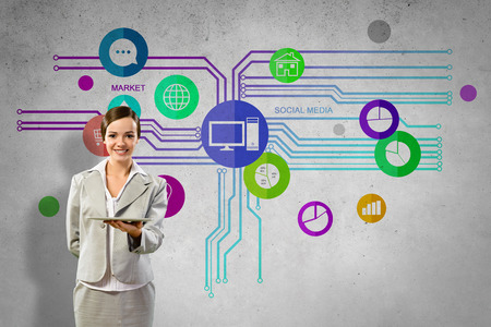 Businesswoman presenting tablet pc and color icons  photo