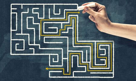 way out: Conceptual image with hand drawning labyrinth pattern
