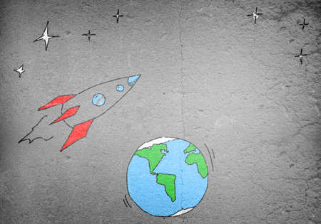 Background image with flying drawn rocket on cement wall