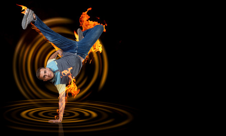 studio b: Young breakdancer performing a hand stand on color background