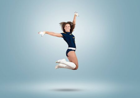 high school girl: Young beautiful smiling cheerleader girl jumping high Stock Photo