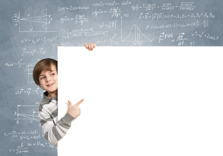 blank board: Cute boy looking from behind blank advertising board