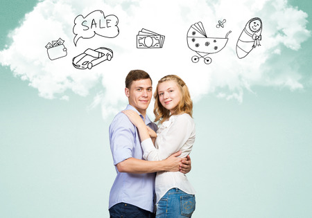 Young happy family couple dreaming of future wealthy life photo