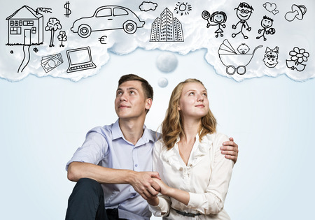 Young happy family couple dreaming of future wealthy life Stock Photo - 37970997