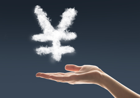 yen sign: Conceptual image with cloud yen sign on palm Stock Photo