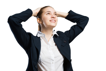 arms behind head: Young businesswoman with arms behind head isolated on white Stock Photo