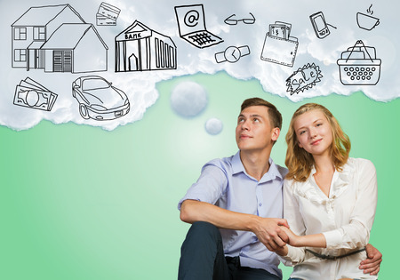Young happy family couple dreaming of future wealthy life Stock Photo - 38590996