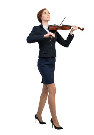 concerto: Young pretty businesswoman playing violin isolated on white Stock Photo