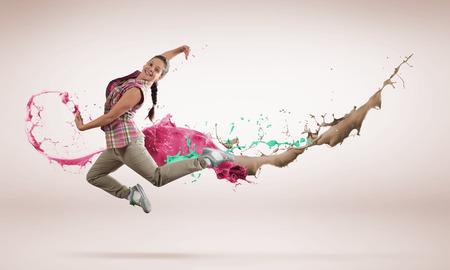 hip hop dancer: Young woman hip hop dancer jumping high
