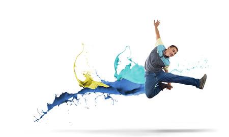 dancer: Young man hip hop dancer jumping high