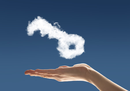 cloud shape: Close up of hand holding key shaped from cloud Stock Photo