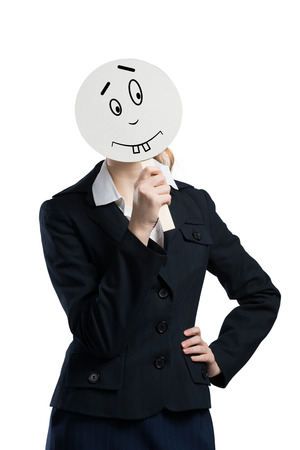 hidden success: Businesswoman hiding her face behind mask isolated on white