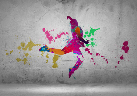 man and woman silhouette: Image with color silhouette of dancer on gray wall