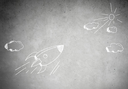 rocket: Background image with flying drawn rocket on cement wall