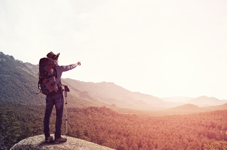 outdoorsman: Young man hiker walking in beautiful mountain nature landscape Stock Photo