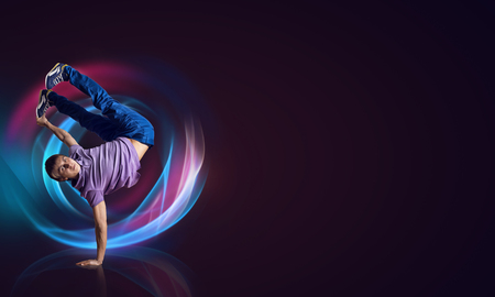 hands fire passion: Young woman hip hop dancer with fire effect at background