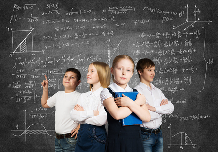 young schoolgirl: Children of school age trying different professions Stock Photo