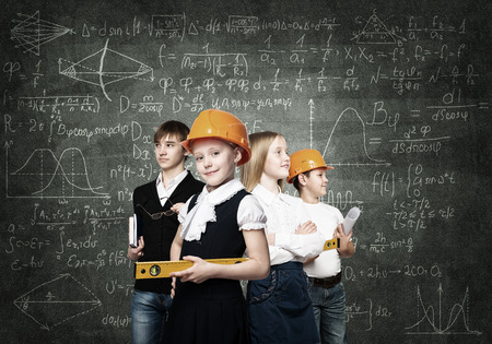 professions: Children of school age trying different professions Stock Photo
