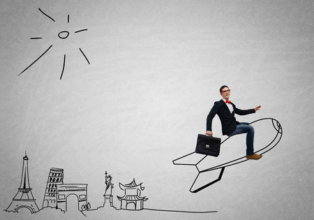 rocket man: Young businessman flying in sky on drawn rocket Stock Photo