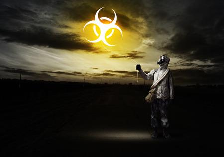 radioactivity: Man in respirator with radioactivity balloon in hands