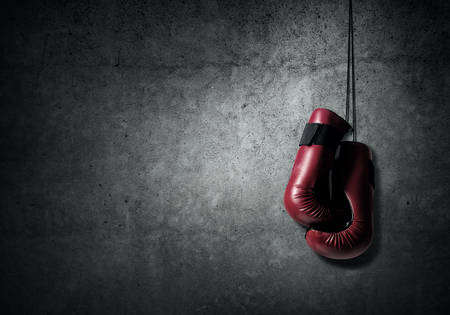 Boxing gloves hanging nailed to wall as concept of retirement Stok Fotoğraf - 45706108