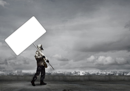 stalker: Stalker in gas mask with blank banner. Place for your text Stock Photo