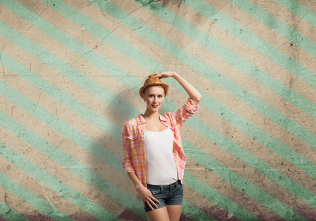stripped: Pretty teenager girl in casual on color stripped background Stock Photo