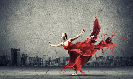 lady in red: Passionate woman dancer in red dress and red spalshes