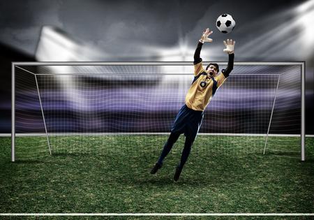 arquero de futbol: Portero en las puertas de salto a Bola de cogida