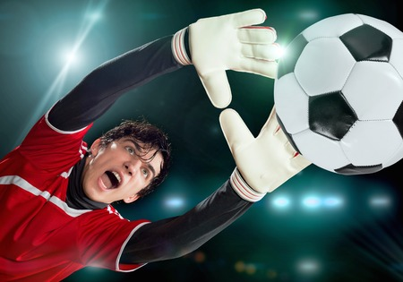 goalkeeper: Portrait of goalkeeper in jump catching ball