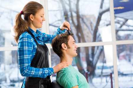 picks: young attractive woman hairdresser hairstyle customer picks Stock Photo