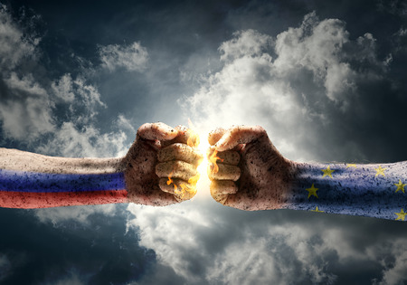 Close up of two fists hitting each other over dramatic sky background Stok Fotoğraf