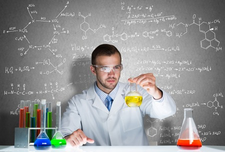 scientist man: Young scientist working with tubes in laboratory Stock Photo