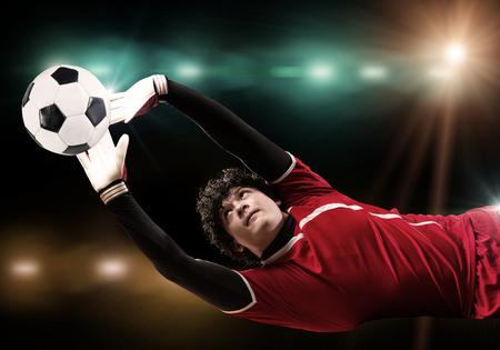 arquero: Retrato de portero en salto Bola de cogida