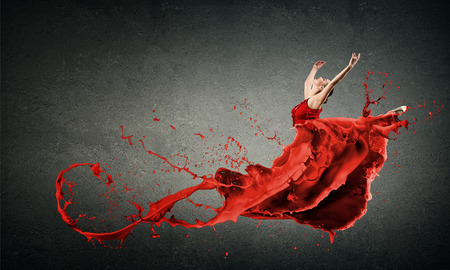 woman red dress: Passionate woman dancer in red dress and red spalshes