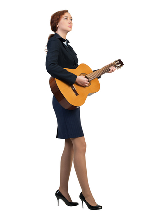 Cheerful Businesswoman Playing Acoustic Guitar Isolated On White Background Photo