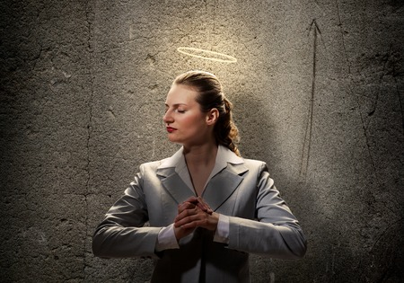 help me: Young saint businesswoman with light above her head