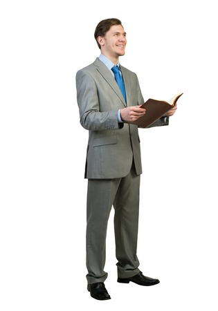 lawer: Young businessman reading book isolated on white background