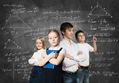 school book: Children of school age trying different professions Stock Photo