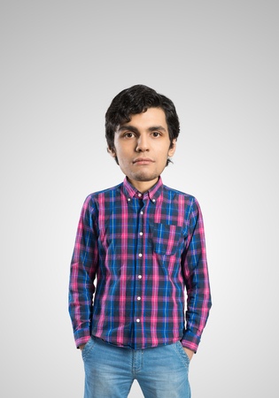 pockets: Funny young bigheaded man in casual with hands in pockets