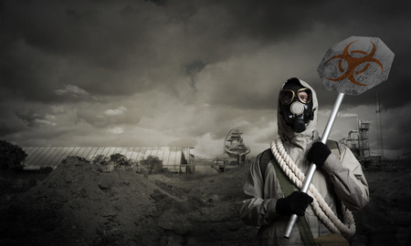 precaution: Stalker in gas mask with precaution danger sign Stock Photo