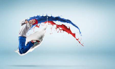 hip hop man: Young man hip hop dancer jumping high