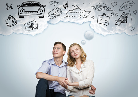 Young happy family couple dreaming of future wealthy life