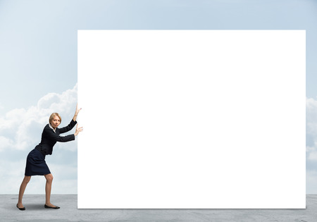 fullbody: Fullbody of businesswoman pushing white blank banner. Place your text