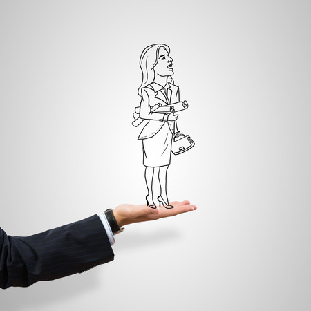 male palm: Drawn businesswoman in male palm on gray background