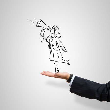 hand work: Drawn businesswoman in male palm on gray background